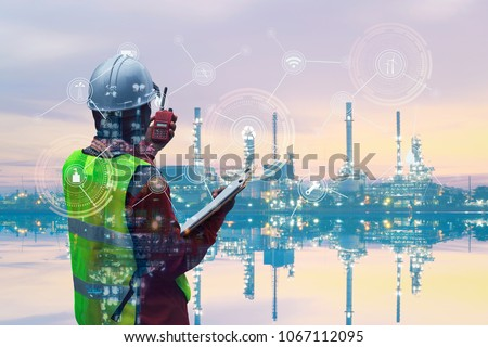 Double exposure of Engineer with oil refinery industry plant background,  industrial instruments in the factory and physical system icons concept, Industry 4.0 concept image #1067112095