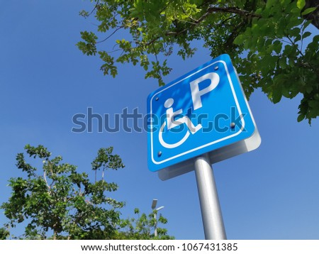 handicap sign board ramp up and park for disable clear blue sky  background