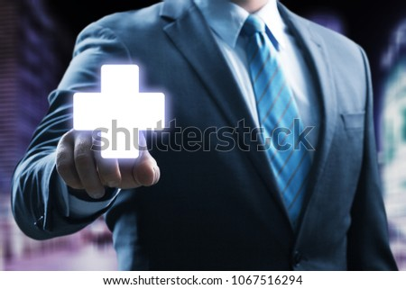 Businessman with medical cross #1067516294