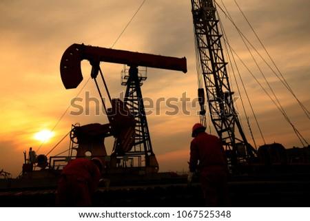 Oil derrick in the setting sun #1067525348