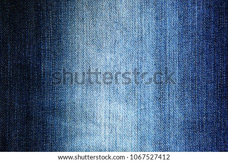 The image of textures of blue denim fabrics for the background.