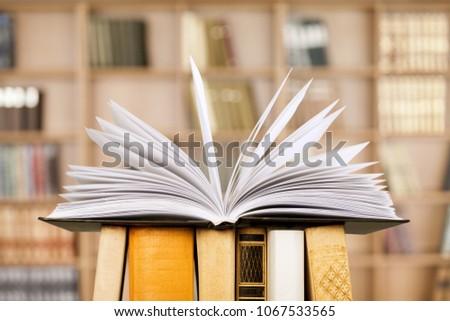 Open books on wooden shelf #1067533565