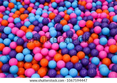 Colorful child balls. Multi-colored plastic balls. Achildren's playroom. Background texture of multi-colored plastic balls on  playground #1067594447