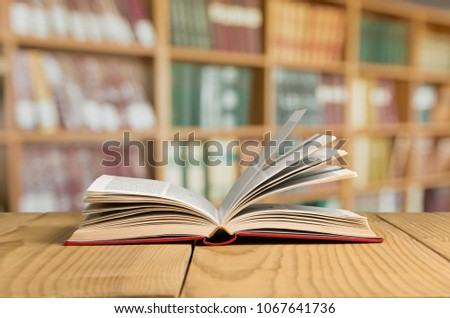 Book in library on tablet #1067641736