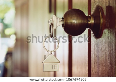 Home key at wooden door #1067694503