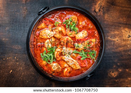 Traditional Creole cajun court bouillon with fish and seafood gumbo chowder stew as top view in a pot with copy space #1067708750