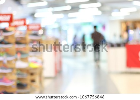 Blur image of People shopping in department store interior. Defocused blur background. #1067756846