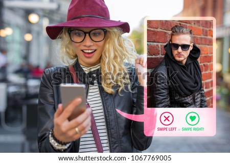 Young woman using dating app on mobile phone #1067769005