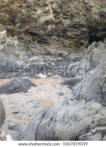Peaceful rocky beach cove in North Devon #1067819039