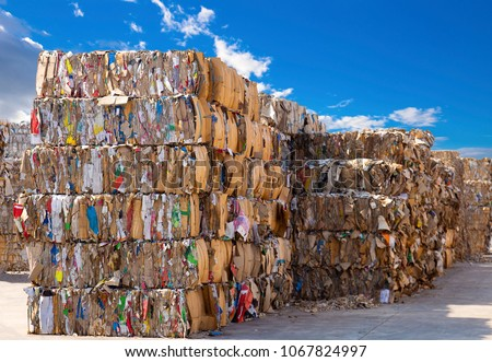 Stack of paper waste before shredding at recycling plant #1067824997