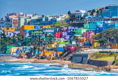 Colorful houses line the hillside over looking the beach in San Juan, Puerto Rico Royalty-Free Stock Photo #1067855027