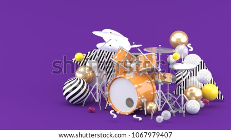 Orange drum amidst colorful balls on purple background. - 3d render.