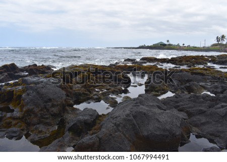 Waves Crashing on Rocky Shore in Hawaii #1067994491