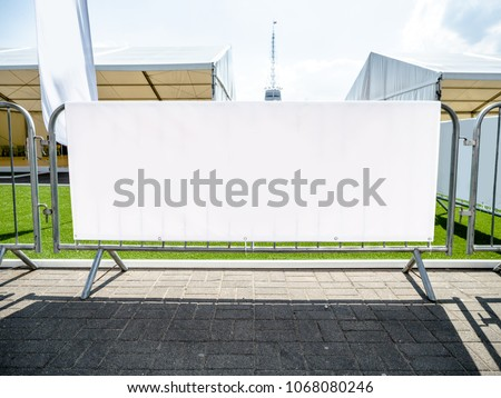 Layered Fabric Banner Mockup, vinyl banners printing, grommet mockup, Corporate outdoor banner, Horizontal Banner Mockup Hanging Outside. Fabric & Scrim Vinyl Banner hanging on the fence. #1068080246