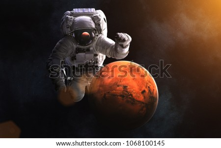 Giant astronaut and Mars. Image in 5K resolution for desktop wallpaper. Elements of the image are furnished by NASA