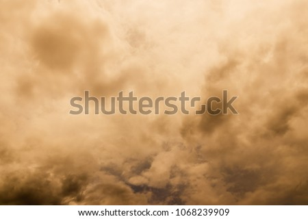 A large storm formed, powdered dust and sand on the ground were blown into the clouds, causing the orange glow to look horrible. extreme weather events. Royalty-Free Stock Photo #1068239909