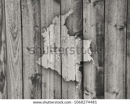 Map of Colombia on weathered wood #1068274481