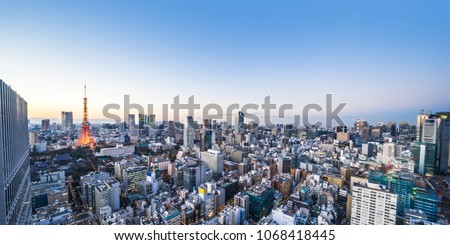 Asia business concept for real estate and corporate construction - panoramic urban city skyline aerial view under twilight sky and neon night in hamamatsucho, tokyo, Japan