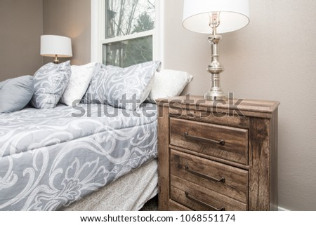 Wooden night stand or bedside table in a bedroom #1068551174
