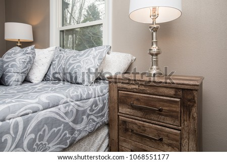 Wooden night stand or bedside table in a bedroom #1068551177