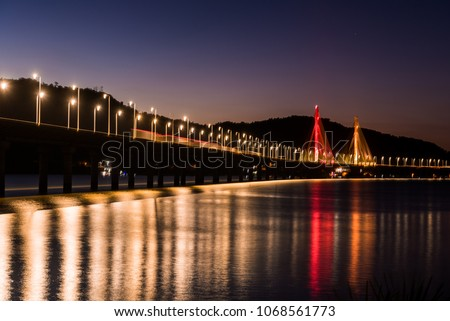 Anita Garibaldi bridge at dusk and illuminated, structure with 2815 meters, is sutuada in the city of Laguna state d Santa Catarina Brazil, Royalty-Free Stock Photo #1068561773