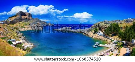 Saint Pauls Bay and Acropolis at Lindos, Rhodes, Greece. #1068574520