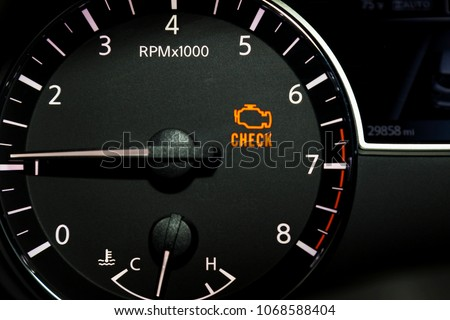 Check engine light illuminated on dashboard.  Royalty-Free Stock Photo #1068588404