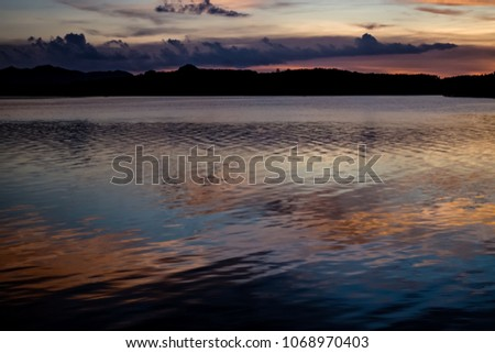Dusk sky reflect on the surface of water #1068970403