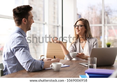 Human resources manager conducting job interview with applicant in office #1069006958