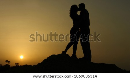Boyfriend and girlfriend kissing on sunset background, happy together forever #1069035314