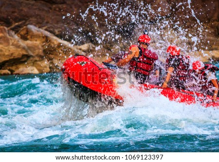 Young person rafting on the river Ganges in Rishikesh, extreme and fun sport at tourist attraction #1069123397