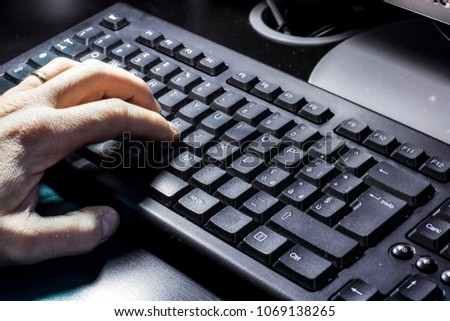 Hand typing on the keyboard #1069138265