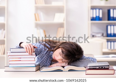 Young female student in educational concept #1069162025