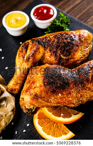 Roasted chicken legs with French fries and vegetables #1069228376