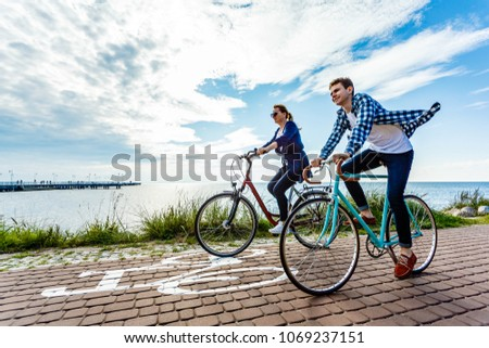 Healthy lifestyle - people riding bicycles #1069237151