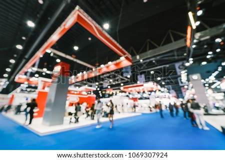 Blur, defocused background of public exhibition hall. Business tradeshow, job fair, or stock market. Organization or company event, commercial trading, or shopping mall marketing advertisement concept #1069307924