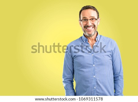 Handsome middle age man confident and happy with a big crazy smile laughing #1069311578