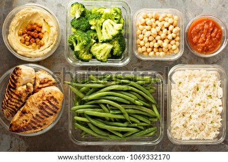 Grilled chicken meal prep with cooked rice and vegetables #1069332170
