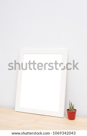Blank frame photo on wood table with copy space #1069342043