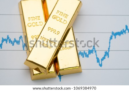Gold bar, bullion stack on rising price graph as financial crisis or war safe haven, financial asset, investment and wealth concept. #1069384970