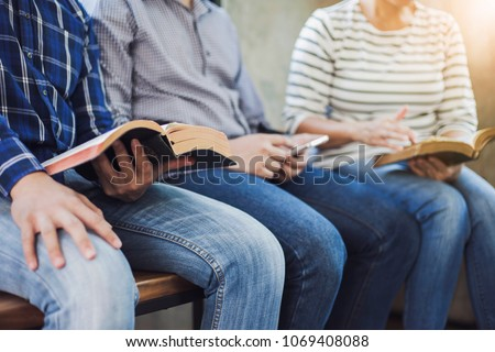 close up of christian group are reading and study bible together in Sunday school class room  #1069408088