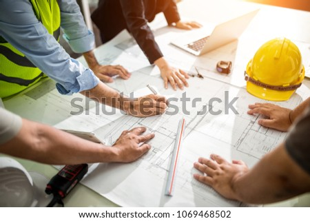 Team Engineer drawing graphic planning of interior creation project cooperating with talented teacher giving advice, working concept. #1069468502