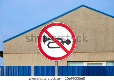Traffic road sign no horn on blue sky background