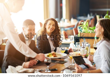 Dinner after a buissnies meeting. hang out Royalty-Free Stock Photo #1069561097