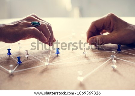 Hands holding connecting pin network #1069569326