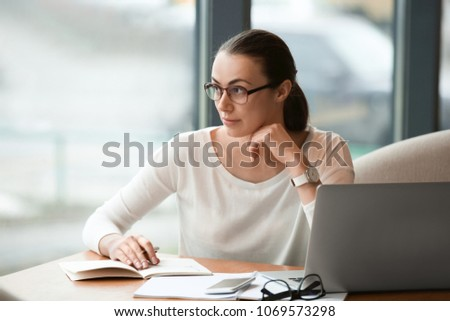 Young freelancer with laptop working in cafe #1069573298