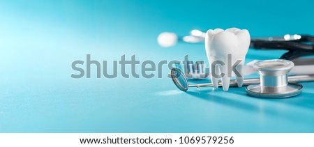 White healthy tooth, different tools for dental care. Dental background. #1069579256