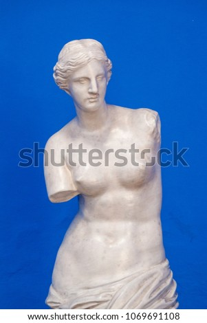venus sculpture isolated in blue
