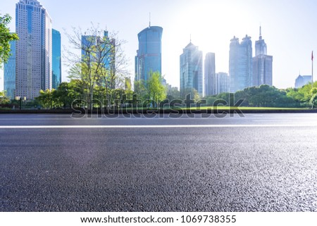 empty asphalt road with modern building #1069738355