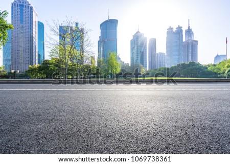 empty asphalt road with modern building #1069738361